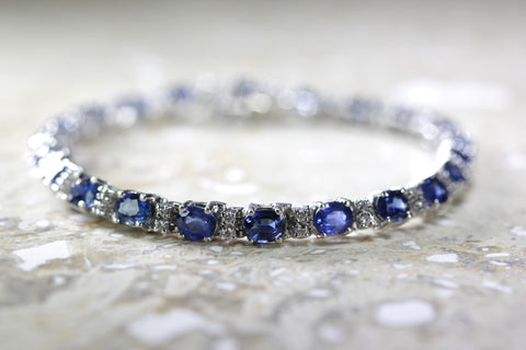 LADIES MODERN DIAMOND & OVAL CUT CEYLON SAPPHIRE TENNIS BRACELET 14k WHITE GOLD