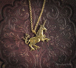 Load image into Gallery viewer, Medieval Unicorn Necklace - Gold Bronze Unicorn Pendant - Small Dainty Charm Necklace - Unicorn Lover Gift - by Woodland Belle