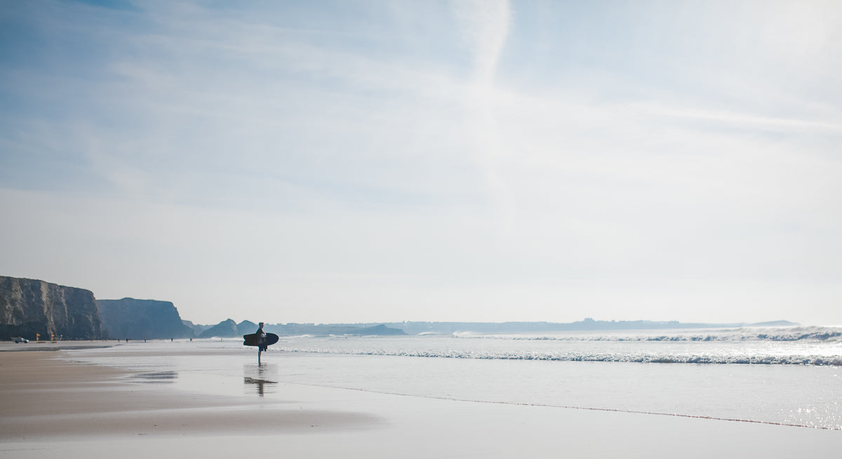 Surfer at Watergate Bay in Cornwall