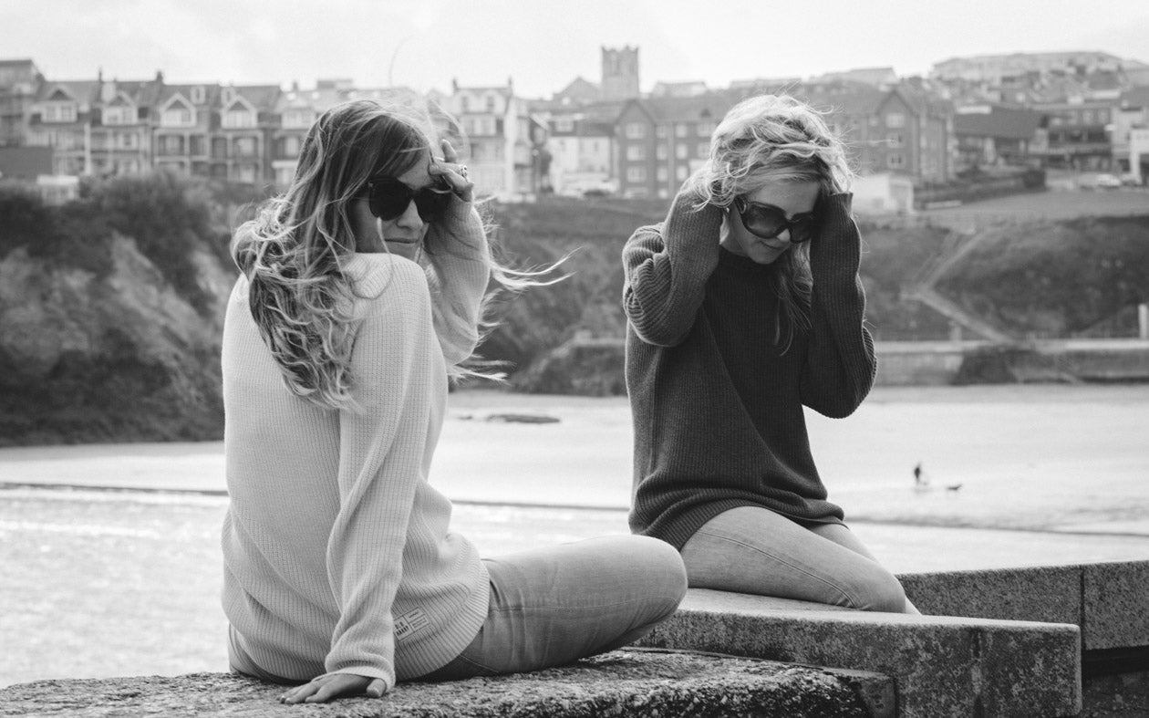 Models wearing sunglasses in Old Harry apparel
