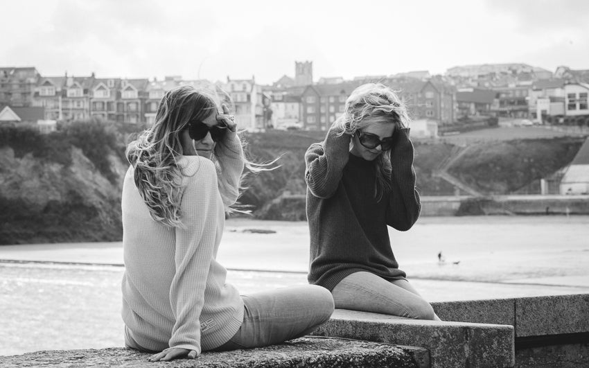 Models sat on the Harbour Wall | Karl Mackie Photographer | Old Harry Knitwear | Newquay, Cornwall