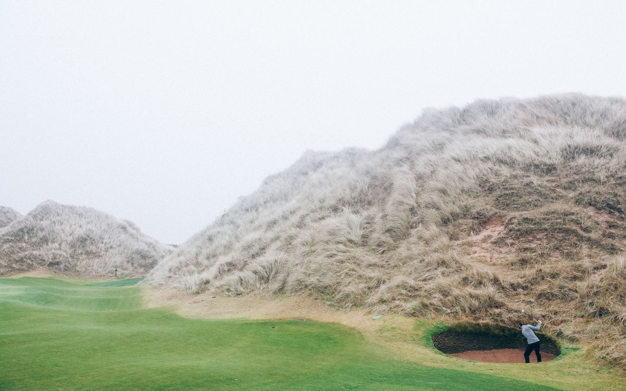 Nicolas Colsaerts low in the bunker in Scotland