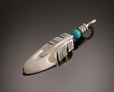 Small Silver Feather with Turquoise Bead Pendant by Ray Tracey ZC23J