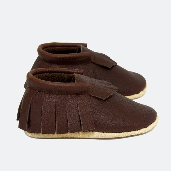 Baby Moccasins - Australian Made - Brown Leather with fringing around sides and back and on top.  Side view.
