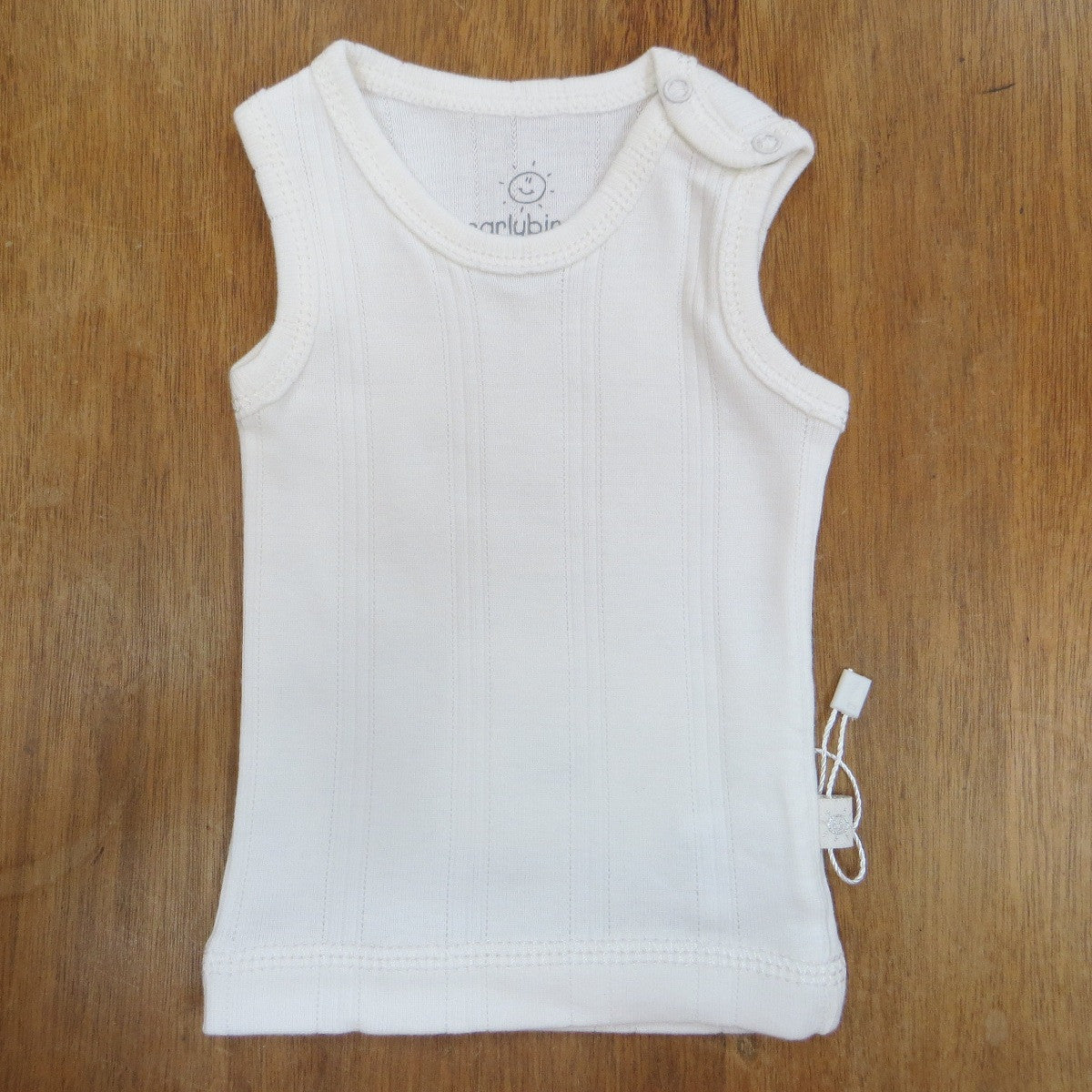 Cotton singlet is lightweight and features an opening on one shoulder