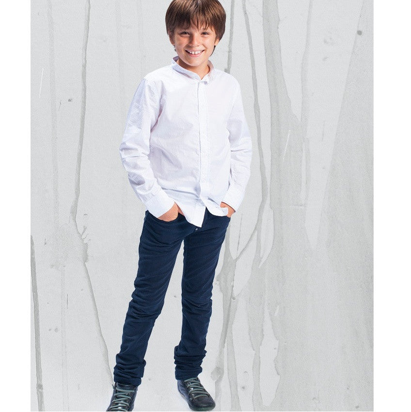 A white long sleeved tailored shirt with detachable collar.  Semi fitted style with buttons up front and on sleeves.