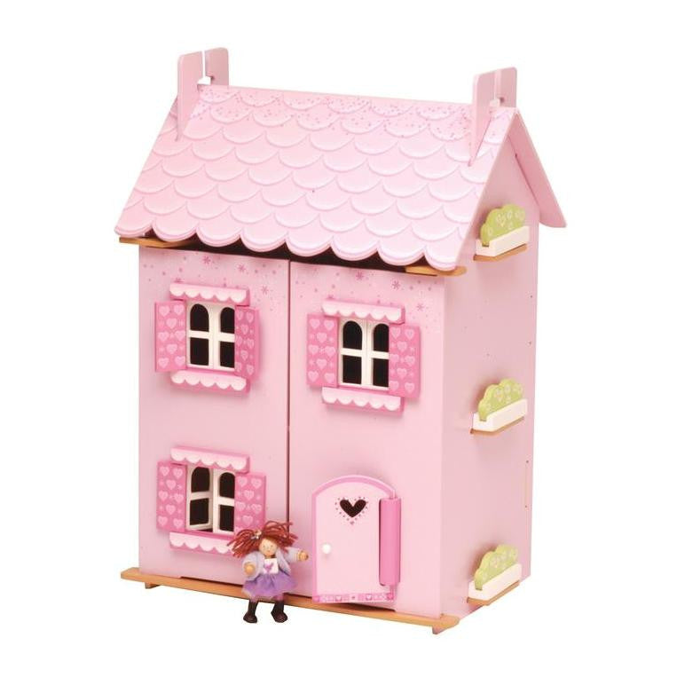 A beautifully painted and decorated doll house with heart motif and opening shutters, windows and door.