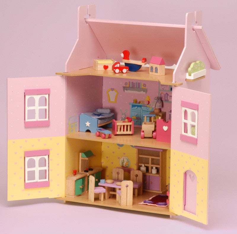 A beautifully painted and decorated doll house with heart motif showing opening shutters, windows and door.