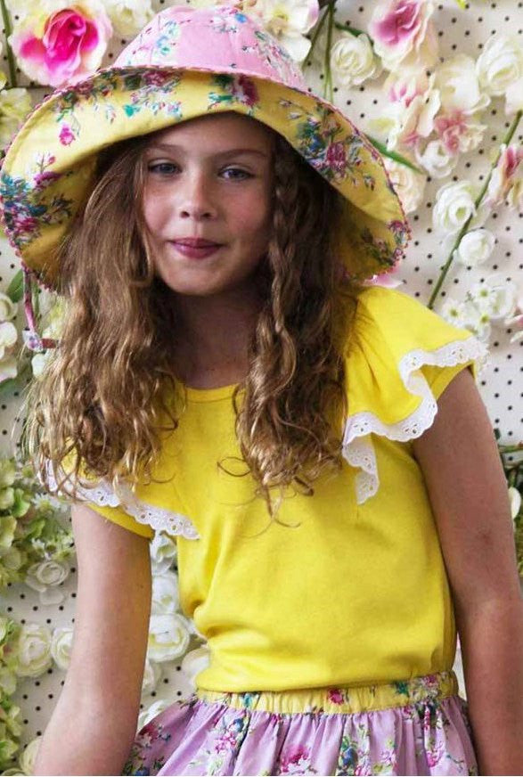 Girl wearing Oobi Flutter Buttercup Tee. Yellow tee with capped sleeves and flutter layer over sleeve.