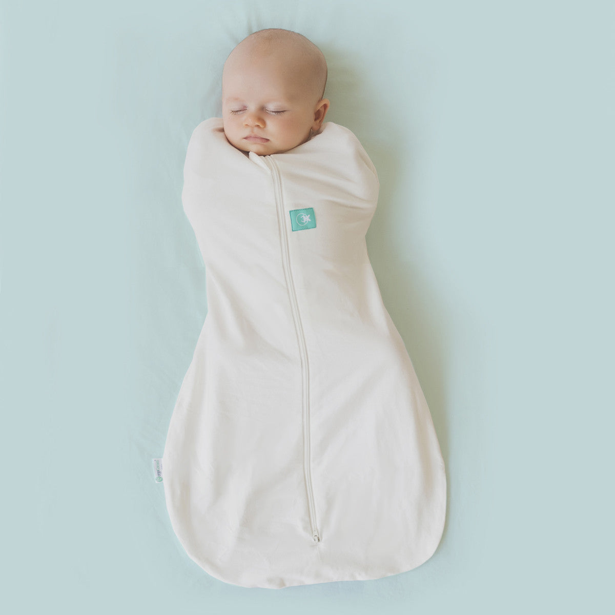 Photo of baby swaddled with both arms in.