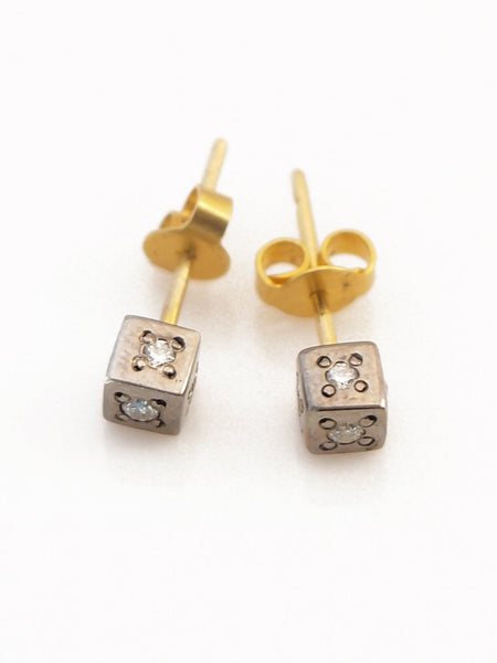 18k  sterling with diamond w diamond center stud earrings