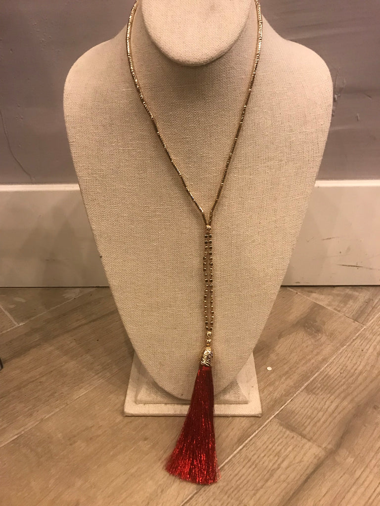 Gold beaded necklace with Red Tassel