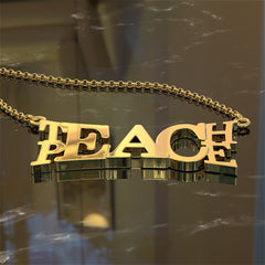 Teach Peace Pendant - A Work of Art that Says It All
