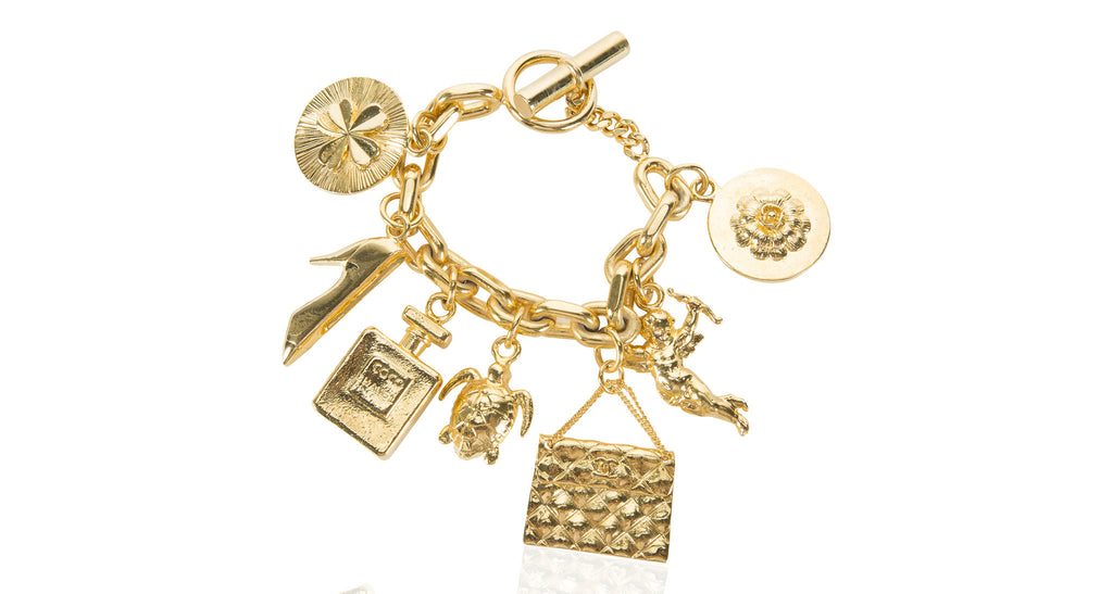 Charm Bracelet, Link Chain with 7 Charms and Toggle Clasp, Circa 1970