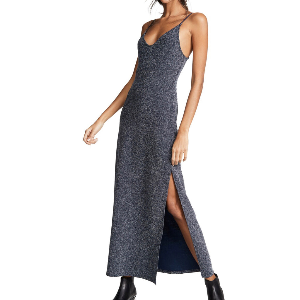 Sparkle and shine this holiday in this navy combo metallic body-skimming maxi dress.  The Lola Maxi features a side slit and V-neckline to layer and accessorize all your funky jewelry for all your holiday parties  18% Metallic, 71% Rayon, 7% Nylon, 4% Spandex  FINAL SALE