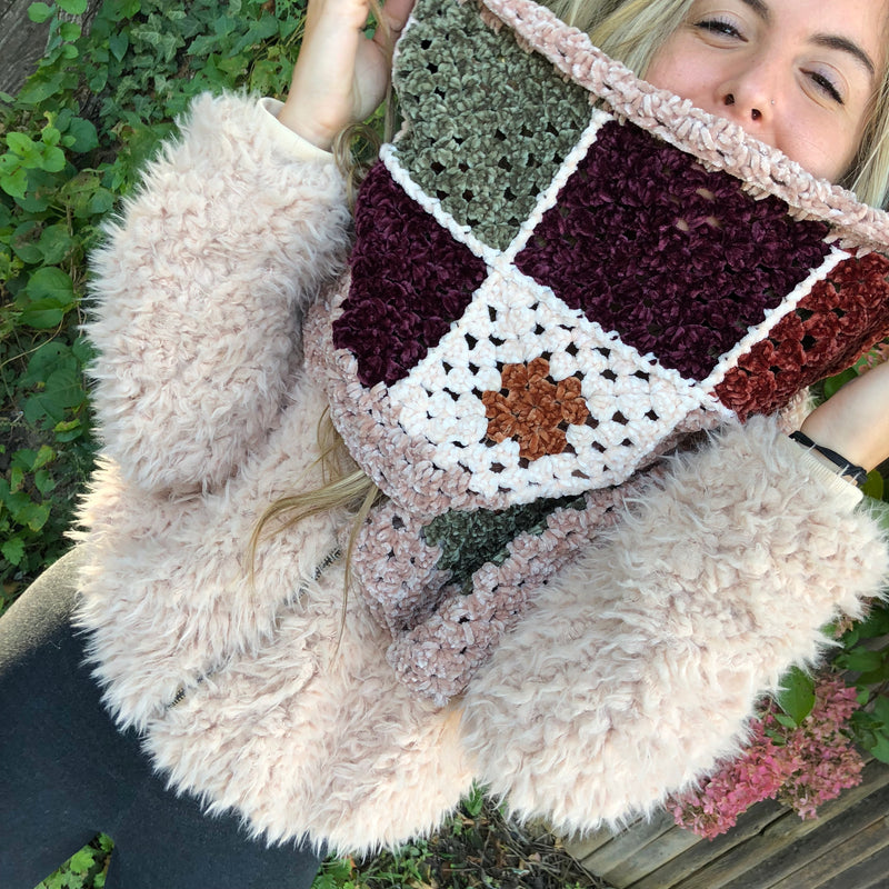 Our favorite crochet granny square scarf.  In a super soft chenille fabric, this retro inspired rectangle scarf is sure to keep you snug and warm during the cold weather months.    100% Polyester