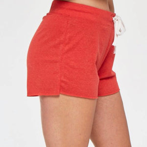 Ready for sunshine in our new Solstice Short. The cozy, relaxed fabric by Project Social T is by far the customer favorite! In a beautiful shade of red, these shorts feature a raw hemline and a drawstring closure.  Relax not only fashionably but ultra-comfy as well!  50% Polyester, 38% Cotton, 12% Rayon