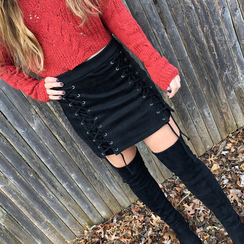Our new Alexis Lace Up Mini Skirt is a fashion staple.  The black suede lace up mini skirt includes silver hardware, a zipper closure with a hook and eye.  Dress it up with your favorite boots, or dress it down with sneakers.  The PERFECT fashion piece to wear to all the upcoming holiday parties.  100% Cotton