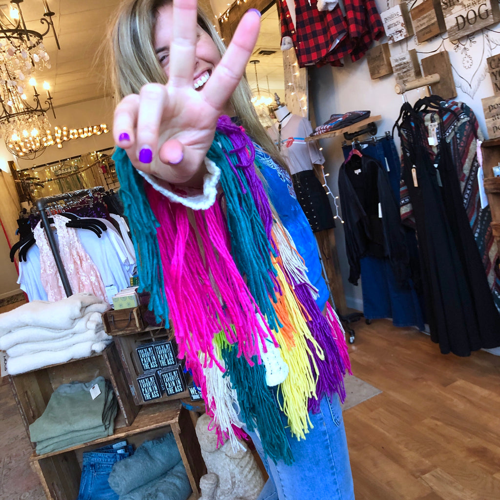 Brighten up your outfit in our new Rainbow Shagadelic Jacket.  Knit, plush, and shaggy, this jacket is super soft with multiple color shag and a white base.     100% Acrylic Bohemian Festival Jacket