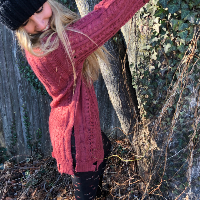 Oversized awesomeness is what this distressed knit tunic sweater is.  In a natural barberry color she makes a great layering piece. Wear with thigh highs and leggings or booties and denim, shoot us a pic with your look.  100 % Acrylic