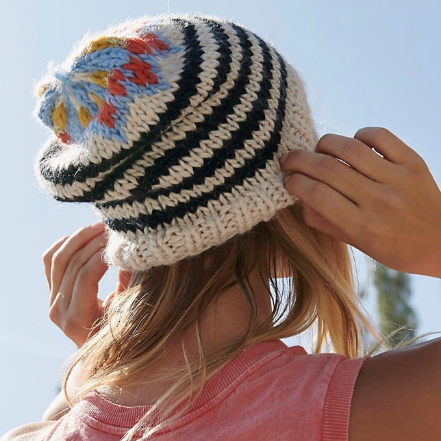 Free People's black and white combo striped knit beanie is the perfect fashion statement to keep you warm this winter.  This beanie features a slouchy silhouette and a multicolored design at the top with metallic details.  70% Acrylic, 30% Wool