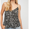 "Breezy and semi sheer, the Kora Printed Cami by Free People is a thin strap cami featuring scalloped edges and a keyhole cut out.  Has adjustable straps.   Machine Wash Cold  Measurements from size Small: 36.5"" Bust, 18.5"" Length."