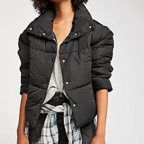 "Stay warm and cozy in this classic puffer jacket featuring tonal snap closures down the front. This Free People slouchy silhouette has hip pockets and a delicious oversized collar. 100% Polyester Measurements for a size small: Bust 48"" Length 24.5"" and Sleeve 20"""