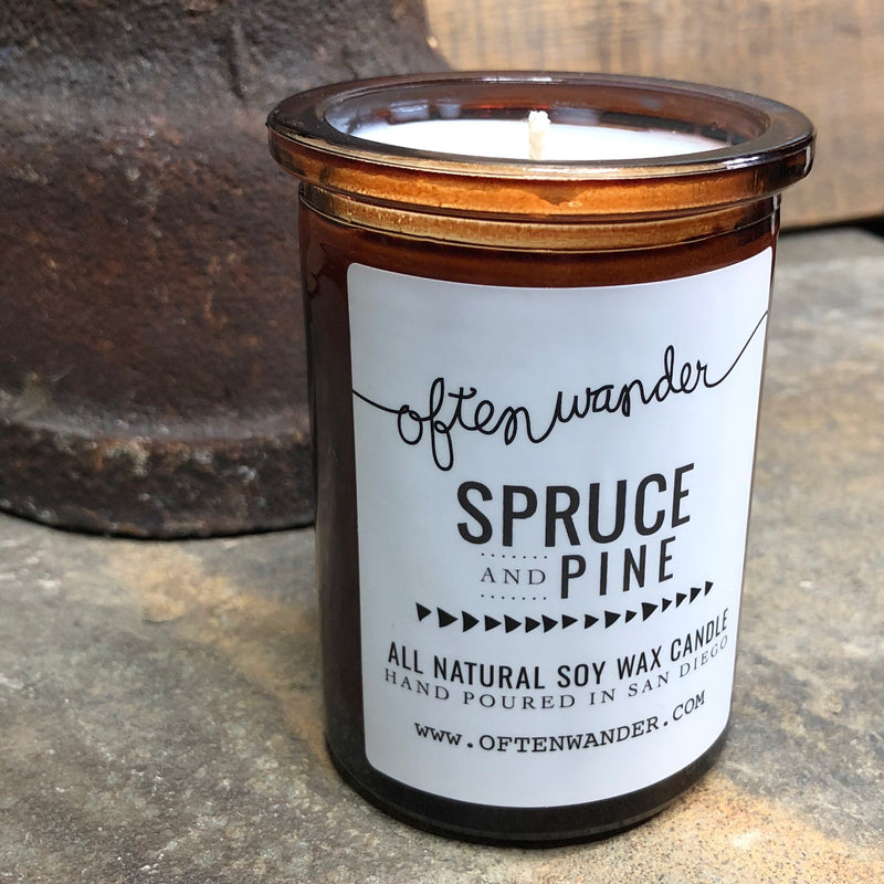 A Holiday favorite! If you love the smell of pine trees as much as we do this time of year, then you'll love the Spruce and Pine Apothec Candle. With hints of balsam and patchouli, the natural freshness of spruce, and fresh cut pine, this candle is sure to put you in the Holiday spirit! All candles are made with 100% organic and eco-friendly soy wax, creating a smooth and creamy soy candle that burns slow and clean.  6 oz.  Organic Soy Wax.