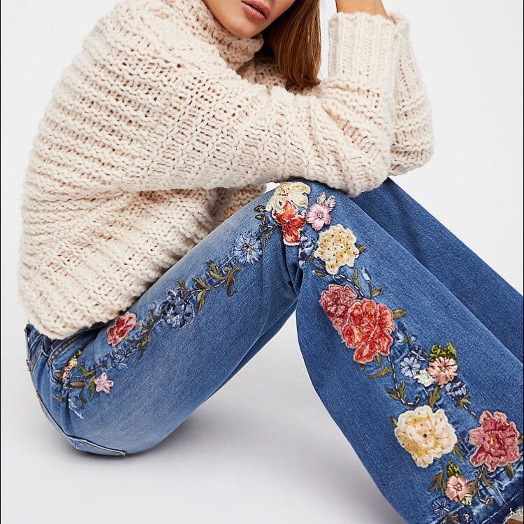 Driftwood Denim Jean's Farrah Flare in a medium wash with beaded floral embroidery running the entire leg length. 34