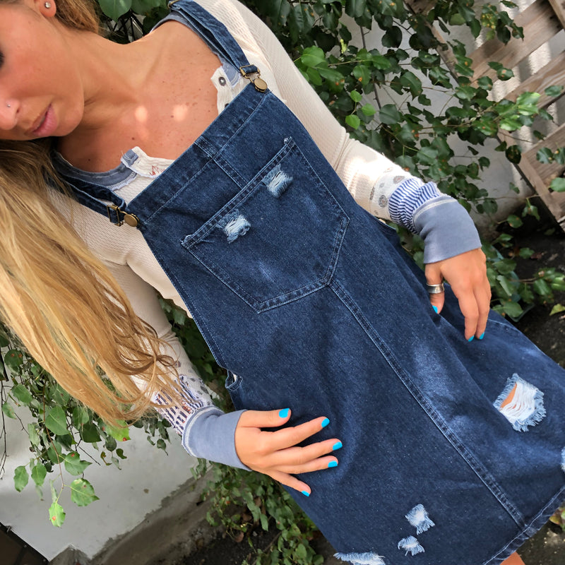 Our Meadow Denim Overall Skirt is 100% cotton, light weight and distressed. This comfy, stretch denim,overall skirt is the perfect everyday casual look.  We love this paired with any tank, tee or bralette. Slip on a sneakers for a casual day out or flip flops and a bathing suit for easy beaching.