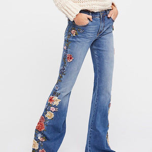 "Driftwood Denim Jean's Farrah Flare in a medium wash with beaded floral embroidery running the entire leg length. 34"" Inseam.  24"" Leg Opening.  9.25"" Rise. 98% Cotton.  2% Sandex. Machine wash"