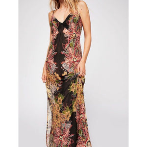 "Wildflower Printed Slip by Free People, an effortless printed maxi slip with a v -neckline and high side slit.  Has adjustable straps, a pull tie back and semi sheer fabrication.  Measurements for size Small: Bust 36"".  Waist 34.5"". Length 52"". 100% Rayon Machine Wash Cold, Gentle"