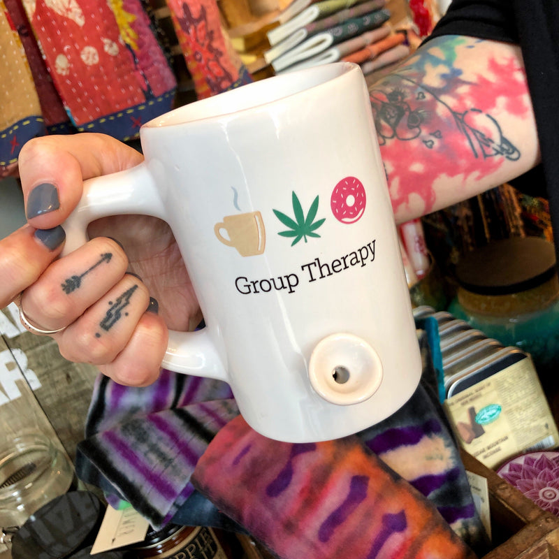 Group therapy the right way.  Wake and bake with our new white ceramic Group Therapy Pipe Mug. This mug holds 8 ounces and has a working pipe bowl on the front and a carb on the handle.   You must be 21 years of age to purchase this product.