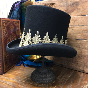 Channel your inner Stevie Nicks in the Best Dressed Top Hat, black tuxedo style hat with gold lace filigree detail.  Wool. BEST DRESSED TOP HAT - Wildflower Long Island