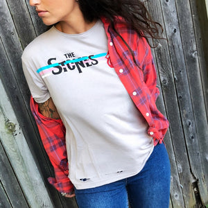 Our soft to the touch vintage inspired tee by Daydreamer features the Stones graphic with a classic t-shirt fit and perfectly undone hem detail.  Graphic features the iconic Rolling Stones tongue with a retro stripe.  50% Cotton.  50% Modal.  Made in the USA  FINAL SALE