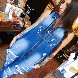 Creative weirdos unite!  The Utility Jumpsuit is an artists dream and will take you through the seasons for work and play.  Sleeveless denim overalls featuring collar detail, button up front, frayed hem, two chest pockets, front slanted pockets, and all-over distressing.  90% Cotton, 9% Polyester, 1% Spandex  Made in USA