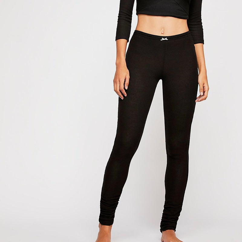 Binge watch Netflix in these oh-so soft ribbed leggings by Free People.  With ruched detail on the hem, an unfinished trim and elastic waistband, you'll look cute on the couch all day.  16% Polyester.  2% Spandex.  82% Rayon.  Measurements for Small: 26.5