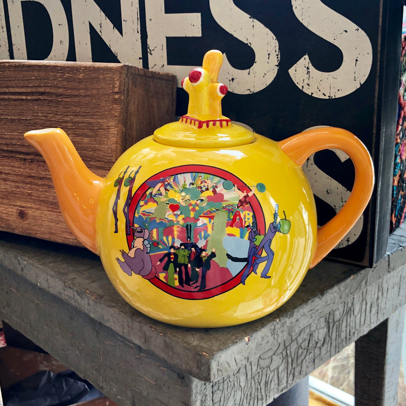 Enjoy your favorite tea while reminiscing with your favorite tunes.  It's tea time with the Beatles!  This beautiful sculpted ceramic yellow submarine teapot is perfect for any Beatles fan!  Cheerfully decorative teapot makes a great gift as well.  Dimensions: 9.8
