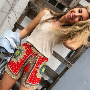 Band Of Gypsies Venice Tassel Short features Beaded tassels and a colorful medallion print bring a world-traveler feel to these gauzy elastic-waist shorts.  Unlined with an an elastic drawstring waist.  100% viscose