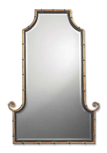 this flat top, arch mirror is framed by an antiqued gold iron rod with matte black inner lip