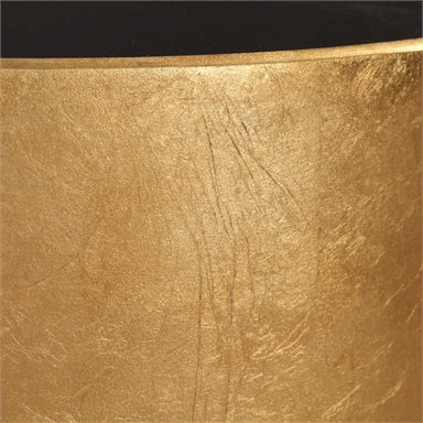 this accent table is finished in hand applied metallic gold leaf with a black glass inset top