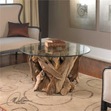 The Le Bois Cocktail table is natural, unfinished teak driftwood sculpted into a sturdy table with a clear glass top.