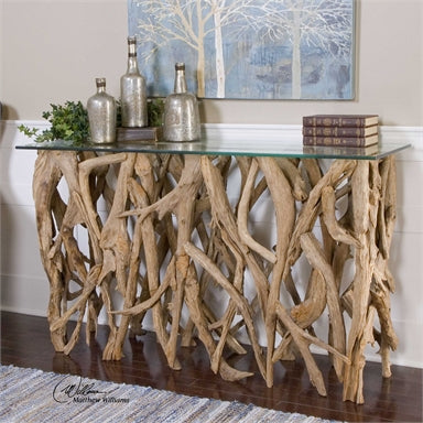 The Woodlands Console Table is made of natural teak wood crafted from its natural form into an artistic and precisely honed sculpture beneath clear glass.