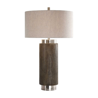 This lamp mixes a contemporary feel with stacked cylinder shapes and a strong rustic design with the faux wood base, finished in an old driftwood stain, accented with a rottenstone glaze and brushed nickel plated details.