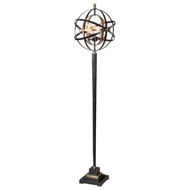 Metal armillary sphere finished in a dark oil rubbed bronze and french gold leaf sitting on top of a sleek tapered base.