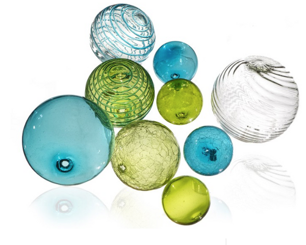 Glass ball wall art in aqua blue, lime green, and clear