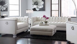 White pearl leatherette Upholstery Set with doorknockers, tufting and chrome legs.