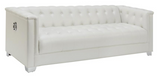 White pearl leatherette Upholstery Sofa with doorknockers, tufting and chrome legs.