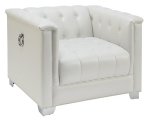 White pearl leatherette Upholstery Chair with doorknockers, tufting and chrome legs.