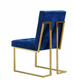 The Quaid Dining Chair has a Hollywood glam look that will take your dining area to another level. Pair this chair with the Quaid Dining Table to complete the look. A boxy geometric shape makes this chair an uber modern addition to your space, while a base of stainless steel makes it durable and tough, so it holds up to heavy daily use. The gold tone finish on the base contrasts nicely with the velvet upholstery used on the seat and back. Heavy tufting adds to the rich appeal of this beautiful design.
